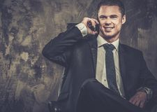Handsome businessman in black suit Royalty Free Stock Image