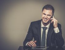 Handsome businessman in black suit Royalty Free Stock Photo