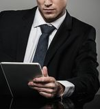 Handsome businessman in black suit Royalty Free Stock Photos