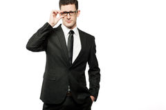 Handsome businessman in black suit on white. Stock Image