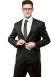 Handsome businessman in black suit on white. Royalty Free Stock Photos