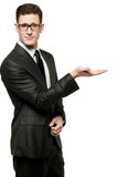 Handsome businessman in black suit on white. Royalty Free Stock Images