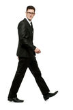 Handsome businessman in black suit on white. Stock Images