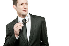 Handsome businessman in black suit on white. Royalty Free Stock Photo
