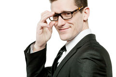 Handsome businessman in black suit on white. Stock Photography