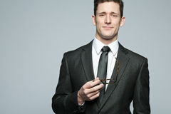 Handsome businessman in black suit. Stock Images