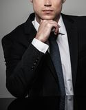 Handsome businessman in black suit Stock Image