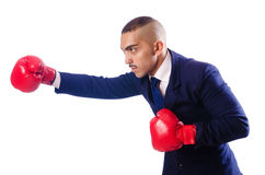 Handsome businessman with boxing gloves Stock Photography