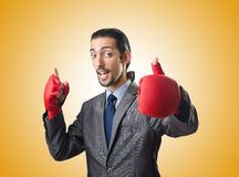 The handsome businessman with boxing gloves Stock Photo