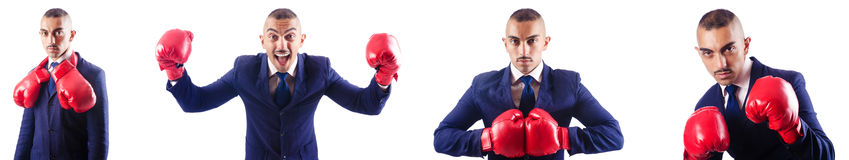 The handsome businessman with boxing gloves Royalty Free Stock Photo