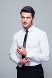 Handsome businessman buttoning shirt Royalty Free Stock Images