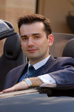 Handsome businessman in cabrio Stock Photography