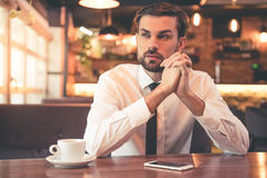 Handsome businessman in cafe Royalty Free Stock Images