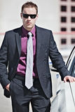 Handsome businessman with car Stock Photography