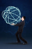 Handsome businessman carrying 3d globe Stock Photography