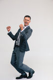 Handsome businessman celebrating his victory Stock Images