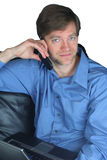Handsome businessman on cellphone and laptop Royalty Free Stock Image