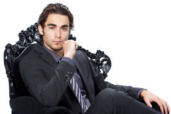Handsome businessman in chair Stock Photography