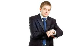 Handsome businessman checking his wrist-watch. Isolated over white Royalty Free Stock Image