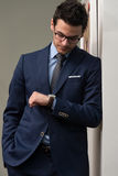 Handsome Businessman Checking Time On His Watch Royalty Free Stock Photography