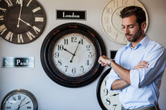 Handsome businessman checking the time Royalty Free Stock Photo