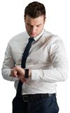 Handsome businessman checking the time Royalty Free Stock Photography