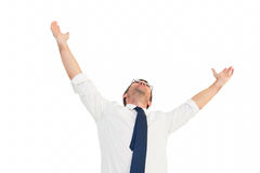 Handsome businessman cheering with arms up. On white background Stock Images