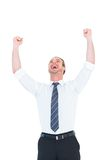 Handsome businessman cheering with arms up. On white background Royalty Free Stock Photos