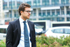 Handsome businessman in the city Stock Image