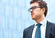 Handsome businessman in the city Stock Photography