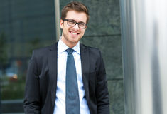 Handsome businessman in the city Stock Photos