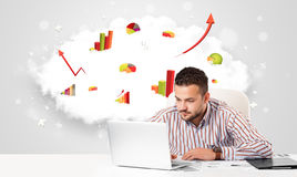 Handsome businessman with cloud in the background containing col Royalty Free Stock Images