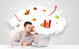 Handsome businessman with cloud in the background containing col Stock Photos