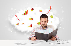 Handsome businessman with cloud in the background containing col Royalty Free Stock Photos