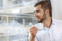 Handsome businessman on coffee break. In cafe Royalty Free Stock Image