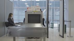 Businessman goes through security check in the airport stock video