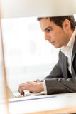 Handsome businessman concentrating on his work Stock Image