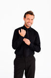 Handsome businessman corrects a cuff link Royalty Free Stock Image