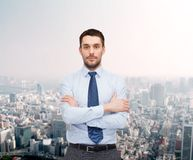 Handsome businessman with crossed arms Royalty Free Stock Image
