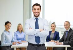 Handsome businessman with crossed arms Royalty Free Stock Photography