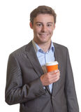 Handsome businessman with a cup of hot coffee Stock Image