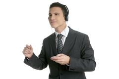 Handsome businessman dancing hearing music Stock Images