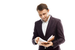 Handsome businessman with diary. Handsome businessman in suit with diary isolated on white Royalty Free Stock Image