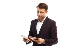 Handsome businessman with diary Royalty Free Stock Photography