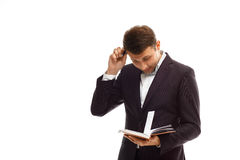 Handsome businessman with diary Stock Image