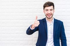 Handsome Businessman doing thumbs up gesture. Business and succe Stock Image