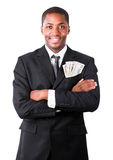 Handsome businessman with dollars in a pocket Royalty Free Stock Photo