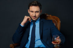 Handsome businessman drinking alcohol Royalty Free Stock Photo