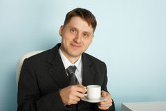 Handsome businessman drinking coffee Stock Photo