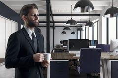 Handsome businessman drinking coffee stock photo
